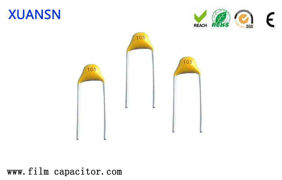 What is the function of monolithic capacitors?